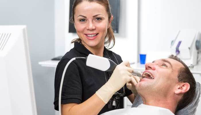 dental professional working on patient