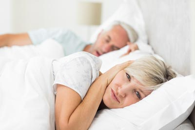Woman annoyed at husband snorring